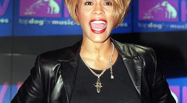 Whitney Houston's dress is to be sold at auction