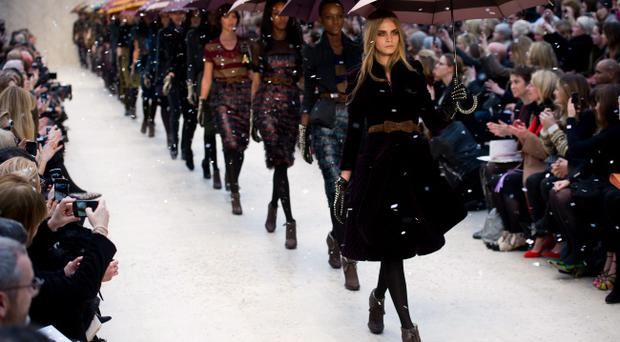 Cara Delevingne and models walk the runway during the Burberry Prorsum show at London Fashion Week Autumn/Winter 2012 at Kensington Gardens