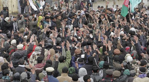 2,000 angry Afghans rallied against the inadvertent burning of Korans at the US air base at Bagram (AP Photo/Musadeq Sadeq)