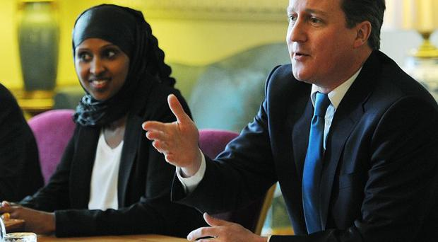David Cameron takes part in a round table discussion as he meets members of the London Somali community