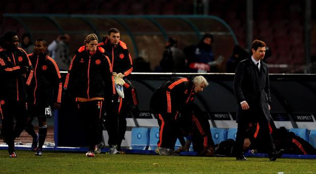 NAPLES, ITALY - FEBRUARY 21: A dejected Andre Villas-Boas the Chelsea manager and his players walk off the pitch following his team's 3-1 defeat during the UEFA Champions League round of 16 first leg match between SSC Napoli and Chelsea FC at Stadio San Paolo on February 21, 2012 in Naples, Italy. (Photo by Mike Hewitt/Getty Images)