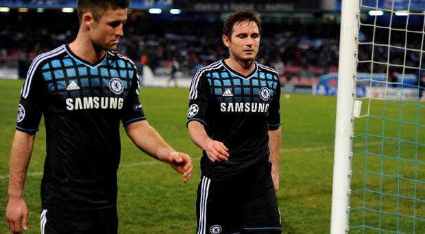 NAPLES, ITALY - FEBRUARY 21: Dejected Chelsea teammates Gary Cahill and Frank Lampard leave the pitch following their team's 3-1 defeat during the UEFA Champions League round of 16 first leg match between SSC Napoli and Chelsea FC at Stadio San Paolo on February 21, 2012 in Naples, Italy. (Photo by Mike Hewitt/Getty Images)