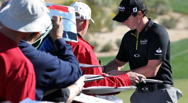 MARANA, AZ - FEBRUARY 21: Rory McIlroy of Northern Ireland signs autographs during a practice round prior to the World Golf Championships-Accenture Match Play Championship at the The Ritz-Carlton Golf Club on February 21, 2012 in Marana, Arizona. (Photo by Sam Greenwood/Getty Images)