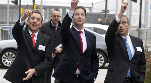 Nick Clegg with InterContinental Hotels Group CEO Richard Solomons, left, and Holiday Inn London Stratford City co-owner John Wagner
