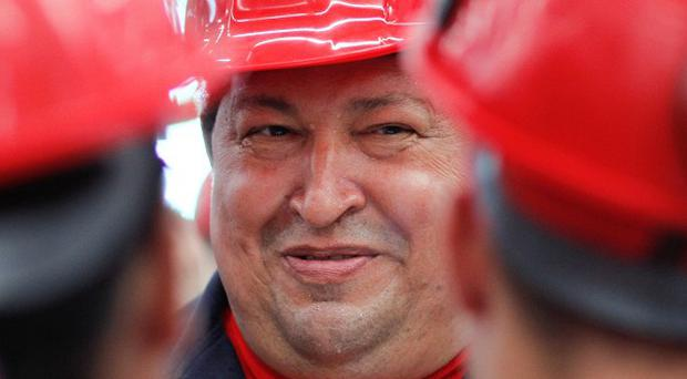 Hugo Chavez is seeking to extend his more than 13 years in power with a new six-year term (AP/Marcelo Garcia, Miraflores Press Office)