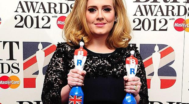 Adele with her two Brit Awards - for best British female artist and best album