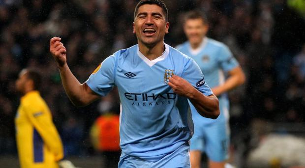 MANCHESTER, ENGLAND - FEBRUARY 22: David Pizzaro of Manchester City celebrates scoring his team's fourth goal during the UEFA Europa League Round of 32 second leg match between Manchester City and FC Porto at the Etihad Stadium on February 22, 2012 in Manchester, England. (Photo by Alex Livesey/Getty Images)