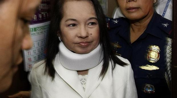 Former Philippine president and now Congresswoman Gloria Macapagal Arroyo arrives at a Pasay City Court in Manila (AP/Bullit Marquez)