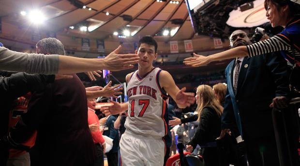 NEW YORK, NY - FEBRUARY 22: Jeremy Lin #17 of the New York Knicks leaves the court after a win over the Atlanta Hawks at Madison Square Garden on February 22, 2012 in New York City. NOTE TO USER: User expressly acknowledges and agrees that, by downloading and/or using this Photograph, user is consenting to the terms and conditions of the Getty Images License Agreement. (Photo by Chris Trotman/Getty Images)