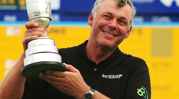 Northern Ireland's Darren Clarke celebrates with the Claret Jug after winning The Open last year