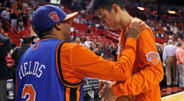 MIAMI, FL - FEBRUARY 23: Jeremy Lin #17 of the New York Knicks greets director Spike Lee during a game against the Miami Heat at American Airlines Arena on February 23, 2012 in Miami, Florida. NOTE TO USER: User expressly acknowledges and agrees that, by downloading and/or using this Photograph, User is consenting to the terms and conditions of the Getty Images License Agreement. (Photo by Mike Ehrmann/Getty Images)