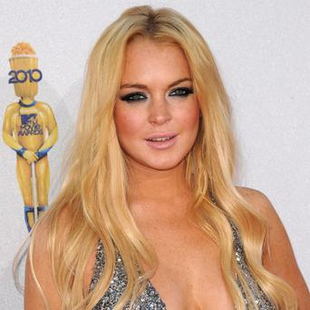 Lindsay Lohan is to play Elizabeth Taylor in a TV movie