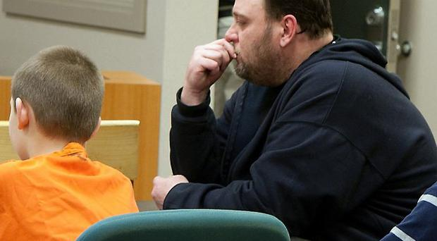 The 9-year-old boy appears in a juvenile court accused of accidentally shooting a classmate(AP)