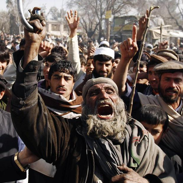 Afghans shout anti-US slogans during a demonstration in Mehterlam, east of Kabul (AP)
