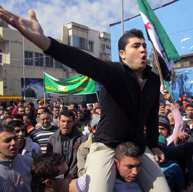 Anti-Syrian regime protesters chant slogans in Tripoli, Lebanon (AP)