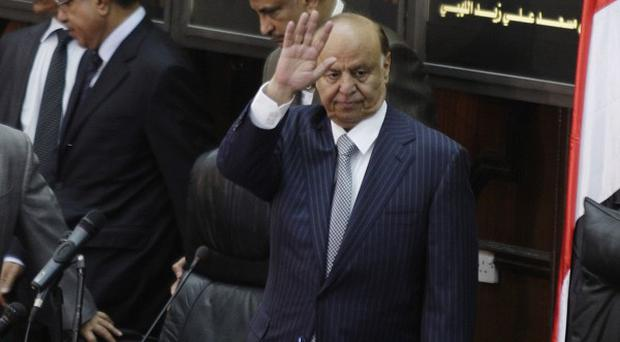Yemen's newly elected President Abed Rabbu Mansour Hadi waves as he arrives to the Parliament in Sanaa (AP)