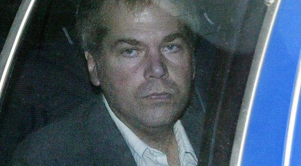 John Hinckley arrives at US District Court in Washington in 2003 (AP/Evan Vucci)