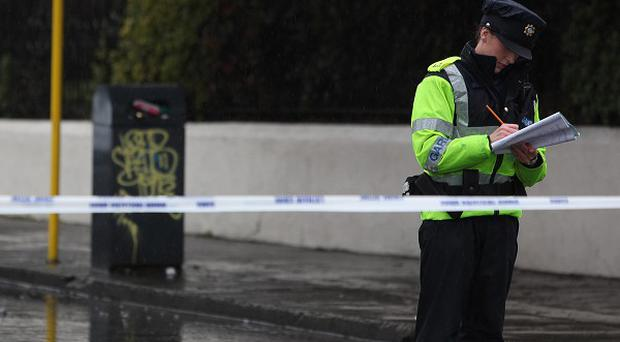One of three people who were allegedly caught in a Co Longford furniture factory was shot