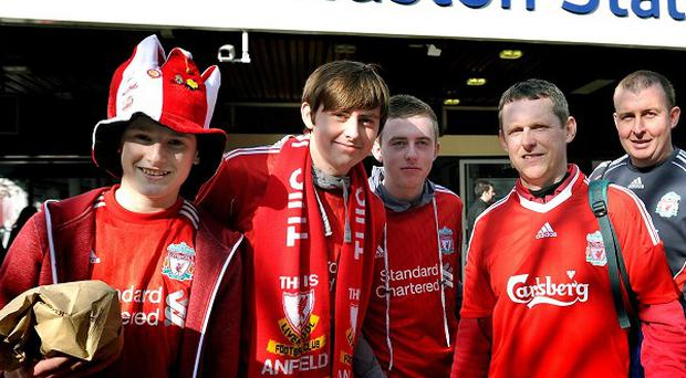 Liverpool fans arrive at Euston station after a delayed journey by train to watch their team in the Carling Cup Final