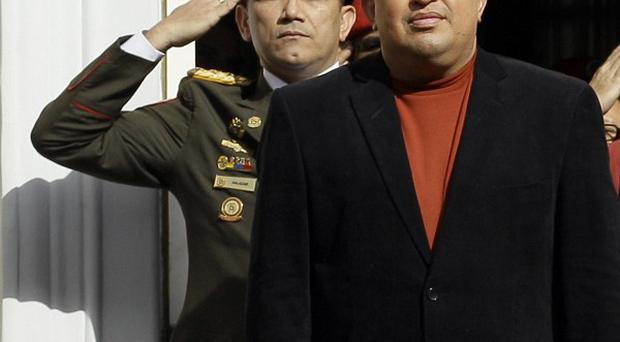 Hugo Chavez receives military honors outside Miraflores presidential palace in Caracas, Venezuela (AP/Fernando Llano)