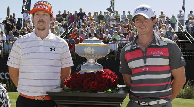 Hunter Mahan, left, and Rory McIlroy, of Northern Ireland, stand for a photo next to the Walter Hagen Cup before playing in the final round of the Match Play Championship golf tournament on Sunday, Feb. 26, 2012, in Marana, Ariz. (AP Photo/Eric Risberg)