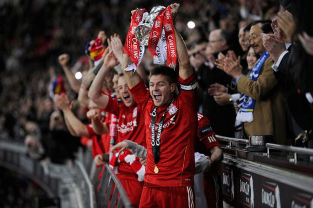 Liverpool captain Steven Gerrard lifts the Carling Cup trophy after victory over Cardiff City