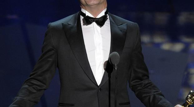 Jean Dujardin accepts the Oscar for best actor in a leading role for The Artist (AP/Mark J Terrill)