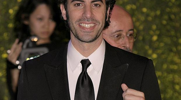 Sacha Baron Cohen has issued a joke threat to the Academy