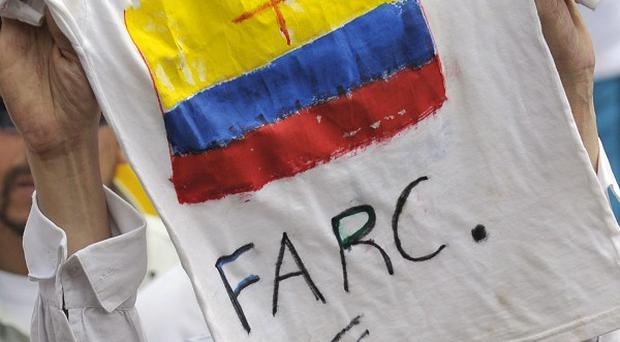 A woman holds a T-shirt against the rebels of the Revolutionary Armed Forces of Colombia (AP/Carlos Julio Martinez)