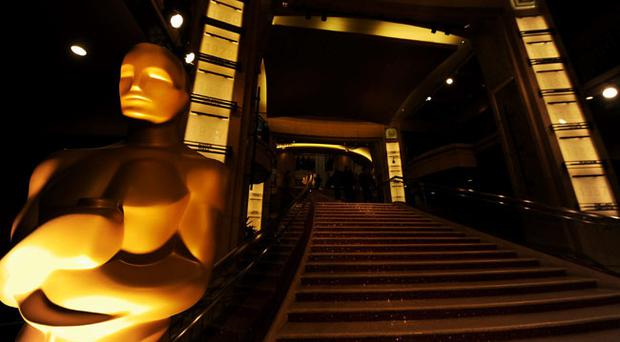 The Oscar statue is seen at the entrance of the Hollywood & Highland Center at the 84th Annual Academy Awards