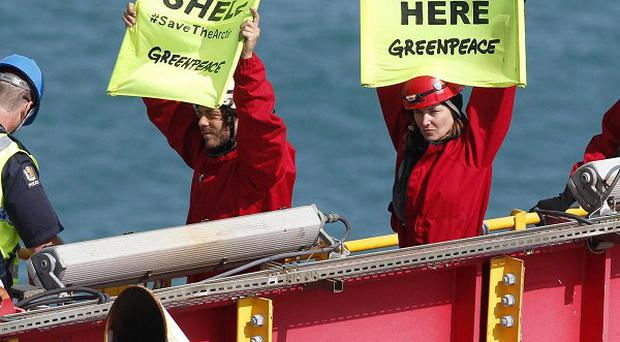 Lucy Lawless and a group of Greenpeace activists were arrested by police