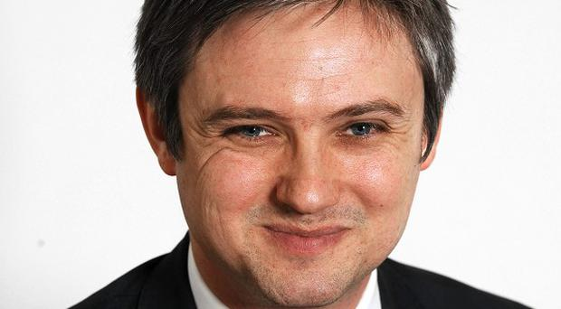 Labour MP John Woodcock has been assaulted on a train