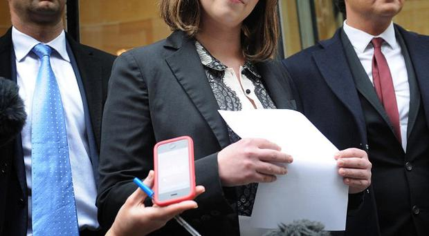 Singer Charlotte Church gives a statement to the media outside the High Court in London