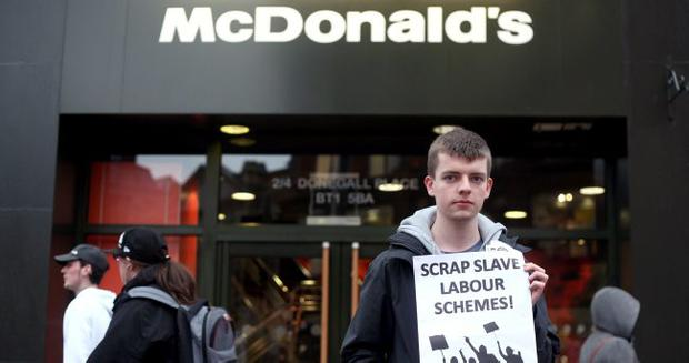A protester makes his point outside McDonald's in Royal Avenue, Belfast