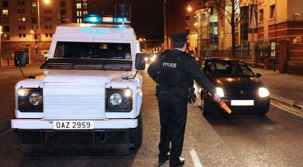 Police officers involved in Operation Ruscio, which is aimed at combating the recent wave of car hijackings in Belfast, on patrol in the west of the city