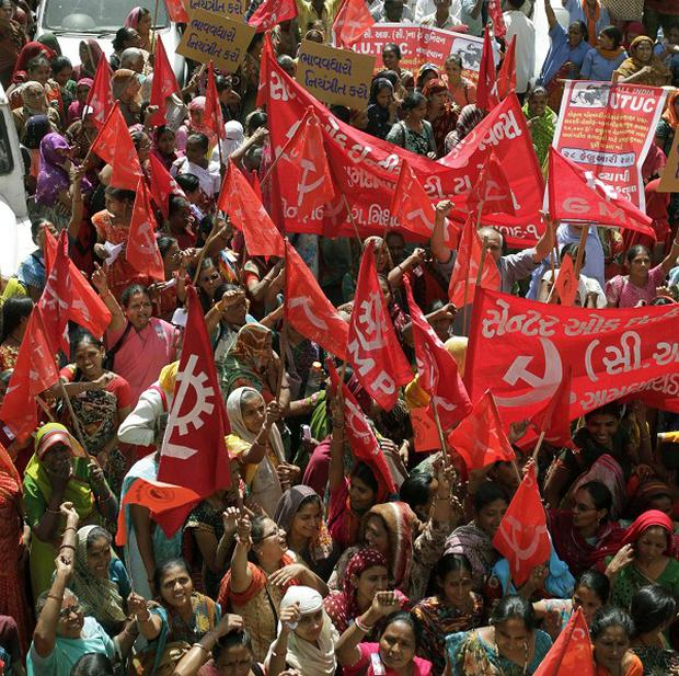 Indian trade union members protest in Ahmedabad during a nationwide strike (AP)