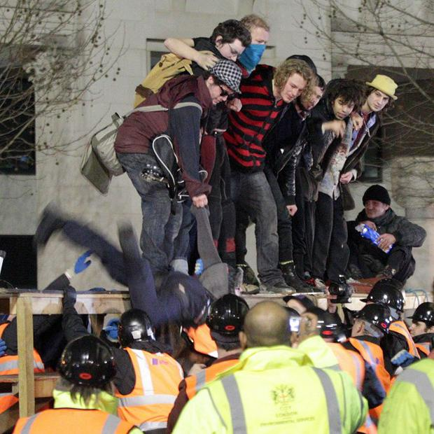 Members of the Occupy camp face down attempts to evict them from in front of St Paul's Cathedral
