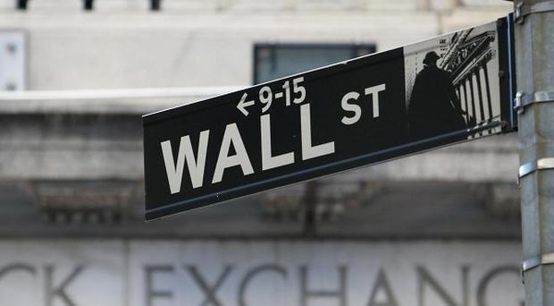 The Dow closed at 13,005, up 23 points