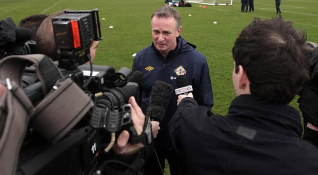 Northern Ireland manager Michael O'Neill speaks to reporters at his first training session.