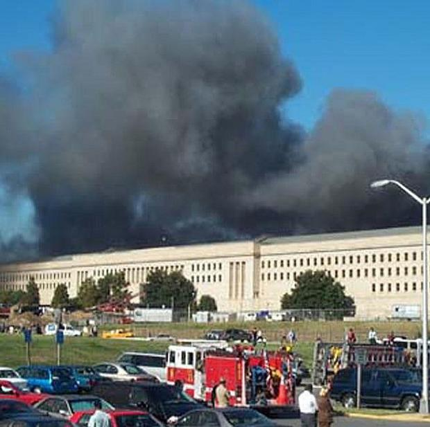 Smoke and flames rise over the Pentagon after an airliner crashed into the side of the building