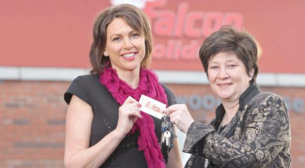 Falcon Holidays new Director of Ireland Helen Caron receives the keys to her new office from former boss Christine Donnelly who leaves the business at the end of February.