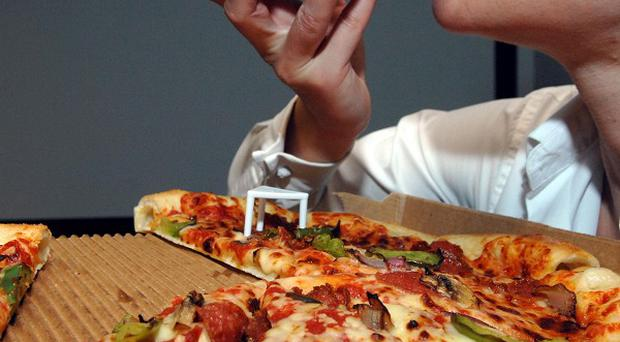 Health experts say people do not realise that bigger takeaway pizzas contain high levels of calories, salt and saturated fat