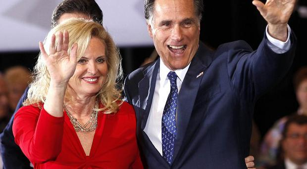 Republican presidential candidate Mitt Romney waves to supporters with his wife Ann after winning the Michigan primary (AP)