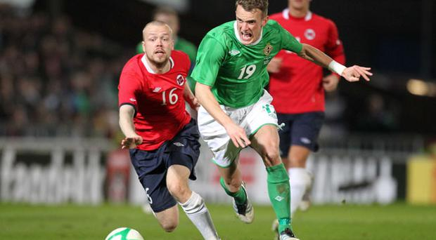 Northern Ireland's Dean Shiels with Norway's Christian Grindheim