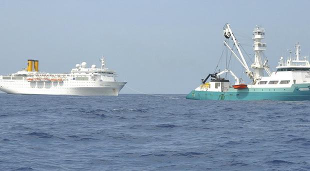 The Costa Allegra is being towed by a French fishing vessel (Reunion Island Prefecture/AP)
