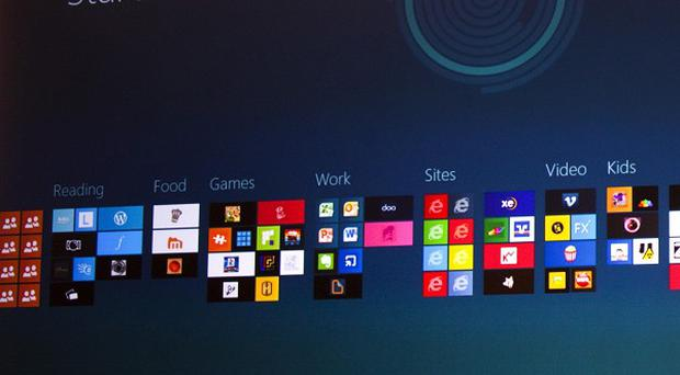 Windows 8 is displayed during a presentation at the Mobile World Congress in Barcelona (AP)