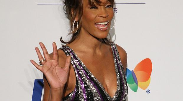 Target said the card was sold in stores before Whitney Houston's death