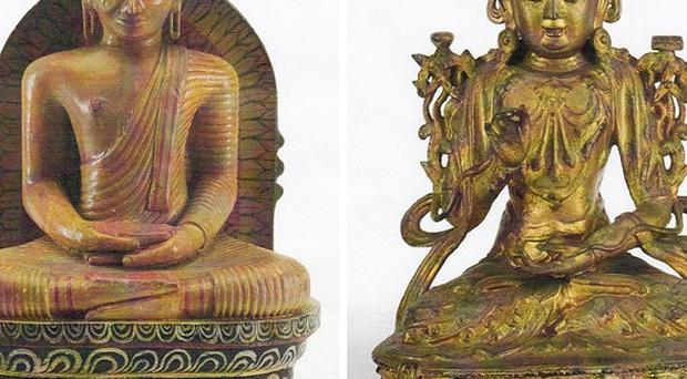 Two stolen Buddha statues, one wooden and one metal, dateing from mid to late 19th century