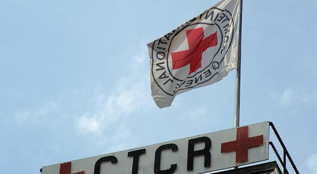 The Red Cross says it has been given permission to enter the besieged Baba Amr neighbourhood(AP)