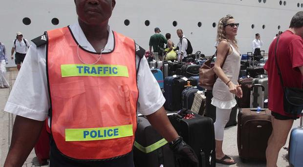 Police were on hand to help the passengers disembarking the Costa Allegra (AP)